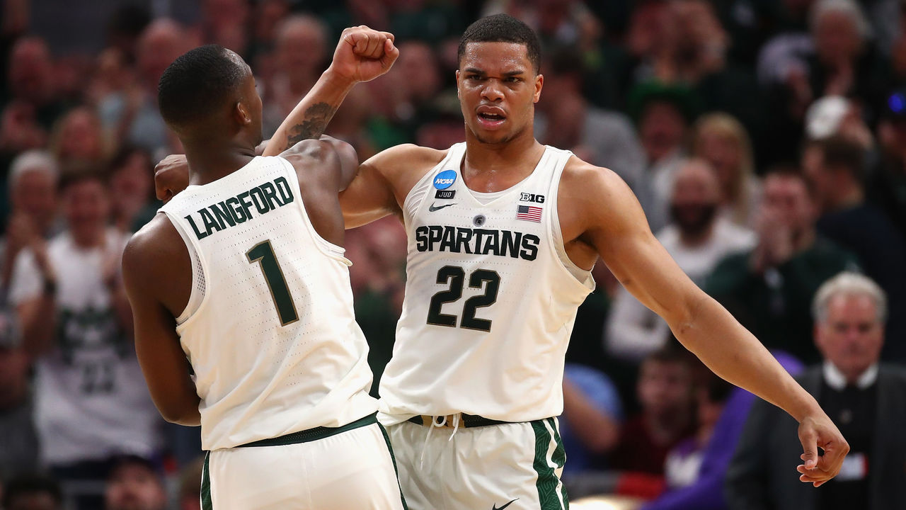 DETROIT, MI - MARCH 16: Miles Bridges #22 of the Michigan State Spartans celebrates with Joshua Langford #1 during the second half against the Bucknell Bison in the first round of the 2018 NCAA Men's Basketball Tournament at Little Caesars Arena on March 16, 2018 in Detroit, Michigan.
