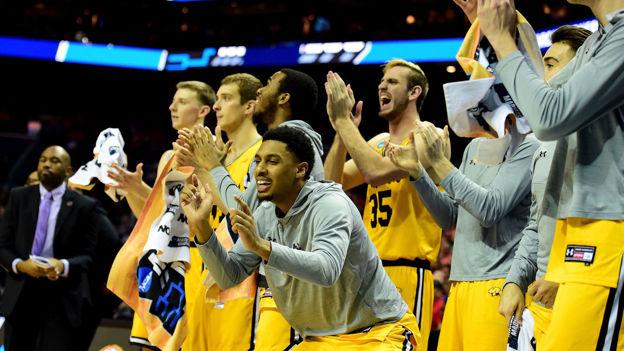 CHARLOTTE, NC - MARCH 16: The UMBC Retrievers bench reacts near the end of the first half against the Virginia Cavaliers during the first round of the 2018 NCAA Men's Basketball Tournament at Spectrum Center on March 16, 2018 in Charlotte, North Carolina.