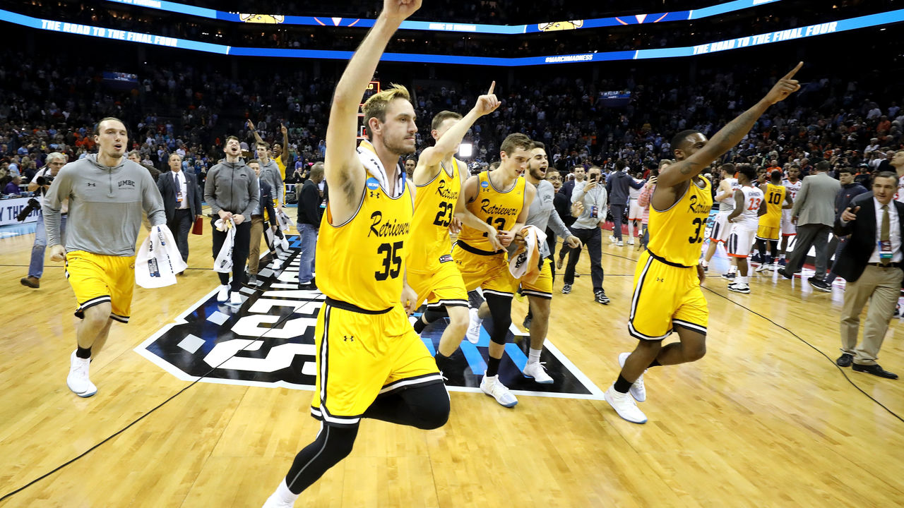 CHARLOTTE, NC - MARCH 16: The UMBC Retrievers celebrate their 74-54 victory over the Virginia Cavaliers during the first round of the 2018 NCAA Men's Basketball Tournament at Spectrum Center on March 16, 2018 in Charlotte, North Carolina.