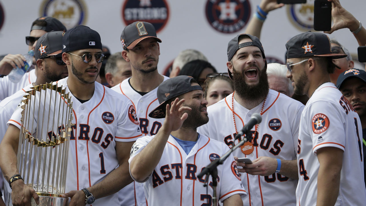 HOUSTON, TX - NOVEMBER 03: George Springer #4 of the Houston Astros is introduced during the Houston Astros Victory Parade on November 3, 2017 in Houston, Texas. The Astros defeated the Los Angeles Dodgers 5-1 in Game 7 to win the 2017 World Series.