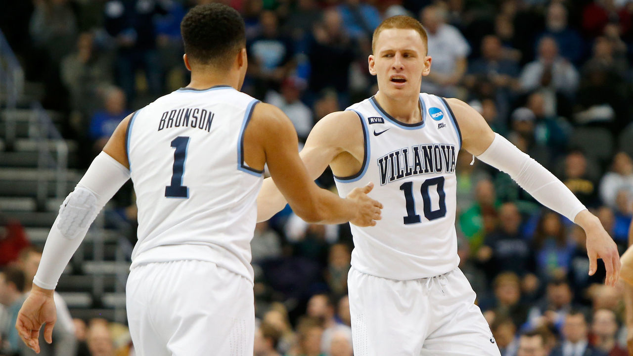 PITTSBURGH, PA - MARCH 17: Donte DiVincenzo #10 of the Villanova Wildcats celebrates with his teammate Jalen Brunson #1 against the Alabama Crimson Tide during the second half in the second round of the 2018 NCAA Men's Basketball Tournament at PPG PAINTS Arena on March 17, 2018 in Pittsburgh, Pennsylvania.