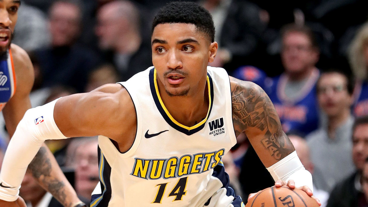 DENVER, CO - JANUARY 25: Gary Harris #14 of the Denver Nuggets drives past Courtney Lee #5 of the New York Knicks at the Pepsi Center on January 25, 2018 in Denver, Colorado.
