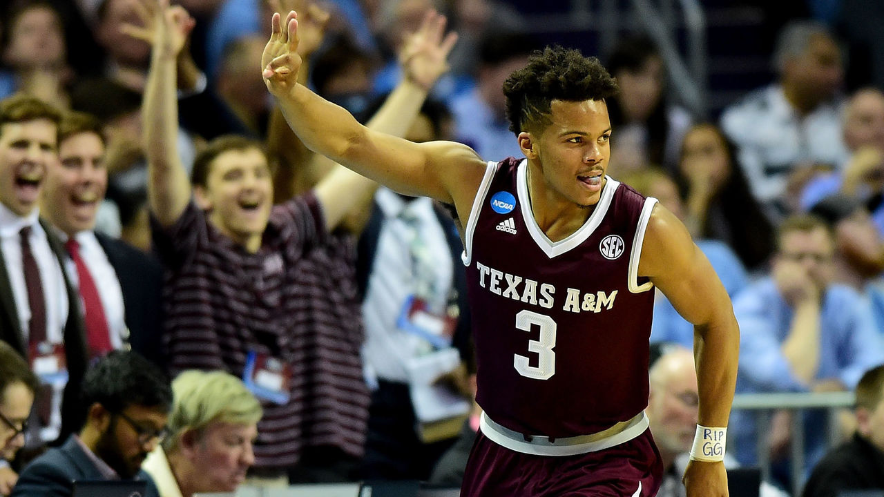 CHARLOTTE, NC - MARCH 18: Admon Gilder #3 of the Texas A&M Aggies reacts after a three point shot against the North Carolina Tar Heels during the second round of the 2018 NCAA Men's Basketball Tournament at Spectrum Center on March 18, 2018 in Charlotte, North Carolina.