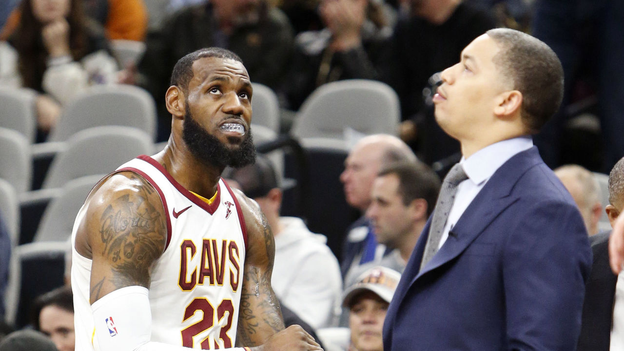 SAN ANTONIO,TX - JANUARY 23 : LeBron James #23 of the Cleveland Cavaliers waits with head coach Tyronn Lue during a time-out in the game against the San Antonio Spurs at AT&T Center on January 23, 2018 in San Antonio, Texas. NOTE TO USER: User expressly acknowledges and agrees that , by downloading and or using this photograph, User is consenting to the terms and conditions of the Getty Images License Agreement.