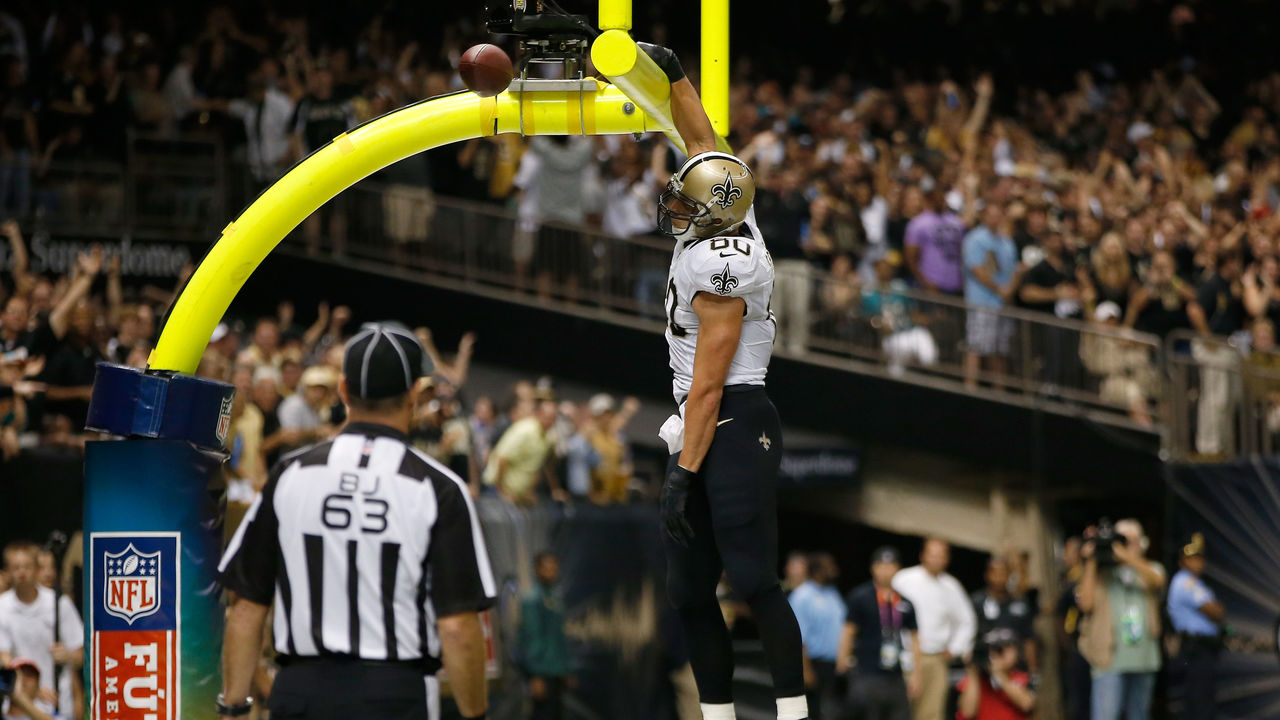 NEW ORLEANS, LA - SEPTEMBER 30: Tight end Jimmy Graham #80 of the New Orleans Saints dunks the ball over the goal post after scoring a 27-yard touchdown in the second quarter against the Miami Dolphins at the Mercedes-Benz Superdome on September 30, 2013 in New Orleans, Louisiana.