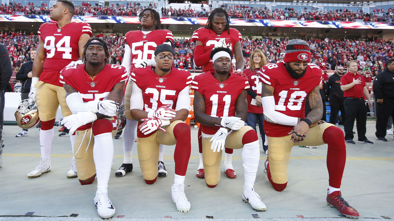 SANTA CLARA, CA - DECEMBER 17: Eli Harold #57, Eric Reid #35, Marquise Goodwin #11 and Louis Murphy #18 of the San Francisco 49ers kneel on the sideline during the anthem as Solomon Thomas #94, Reuben Foster #56 and Adrian Colbert #38 stand with them in support, prior to the game against the Tennessee Titans at Levi's Stadium on December 17, 2017 in Santa Clara, California. The 49ers defeated the Titans 25-23.