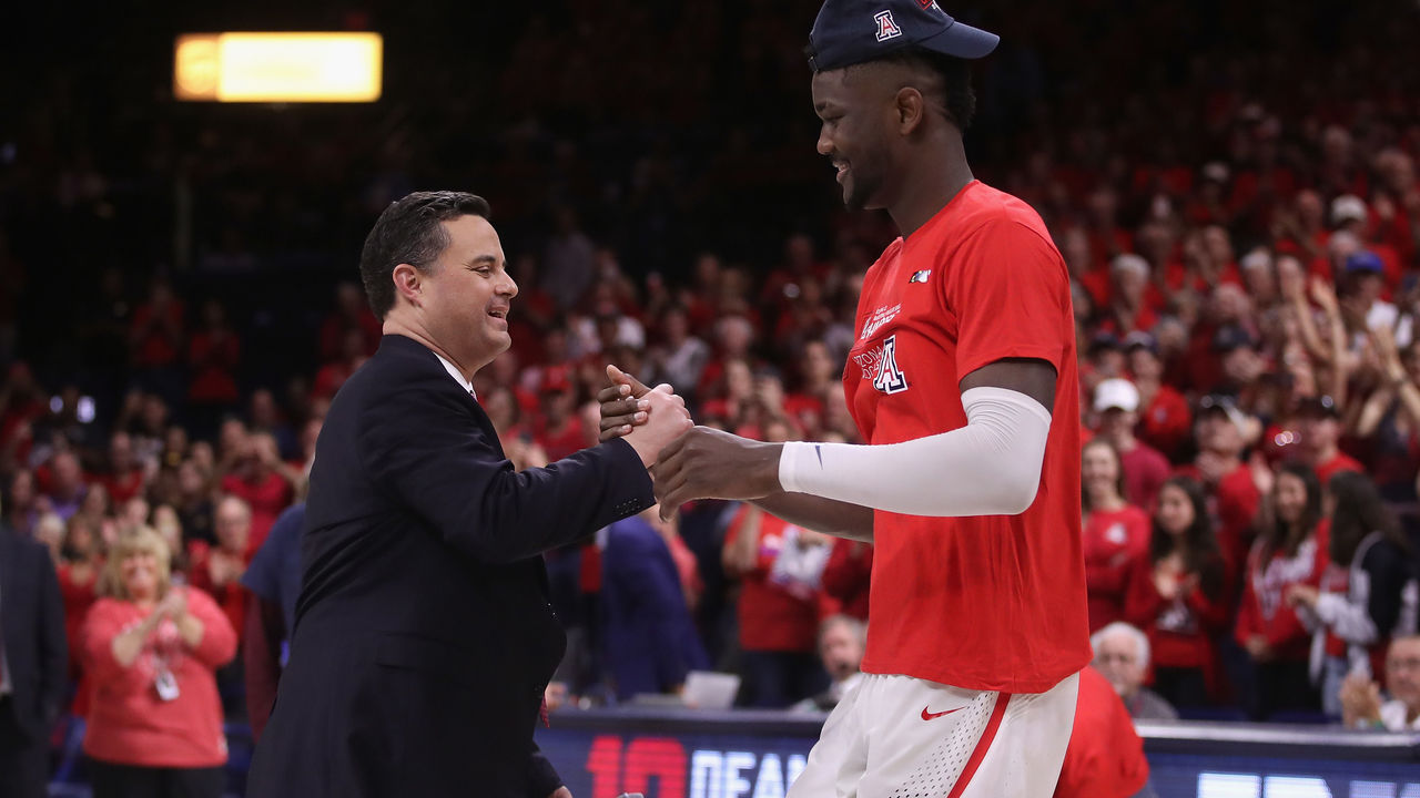 TUCSON, AZ - MARCH 03: Head coach Sean Miller of the Arizona Wildcats greets Deandre Ayton #13 after defeating the California Golden Bears 66-54 to win the PAC-12 Championship at McKale Center on March 3, 2018 in Tucson, Arizona.