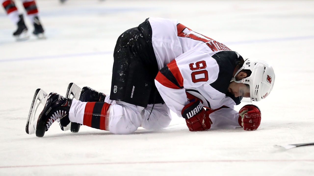 NEW YORK, NY - JANUARY 16: Marcus Johansson #90 of the New Jersey Devils slumps to the ice in the second period after getting injured against the New York Islanders during their game at Barclays Center on January 16, 2018 in the Brooklyn borough of New York City.