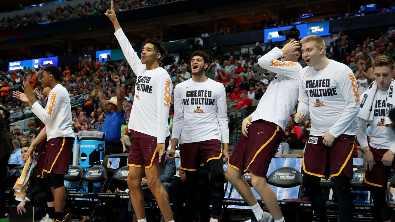 DALLAS, TX - MARCH 17: Members of the Loyola Ramblers bench celebrate in the second half against the Tennessee Volunteers during the second round of the 2018 NCAA Tournament at the American Airlines Center on March 17, 2018 in Dallas, Texas.