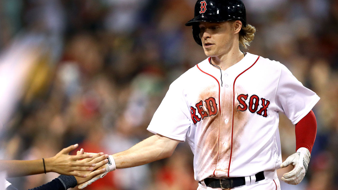 BOSTON, MA - JULY 18: Brock Holt #12 of the Boston Red Sox celebrates with fans after scoring a run against the Toronto Blue Jays during the seventh inning at Fenway Park on July 18, 2017 in Boston, Massachusetts.