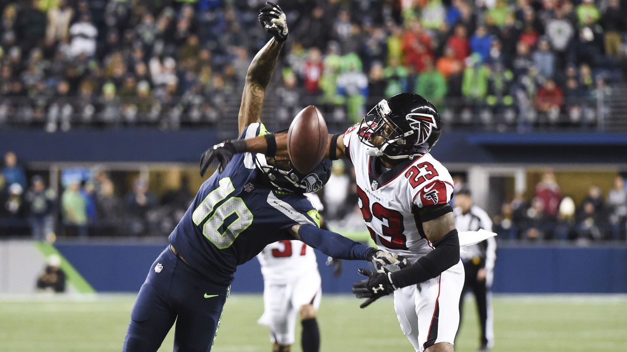 SEATTLE, WA - NOVEMBER 20: Cornerback Robert Alford #23 of the Atlanta Falcons gets called for pass interference on wide receiver Paul Richardson #10 of the Seattle Seahawks during the third quarter of the game at CenturyLink Field on November 20, 2017 in Seattle, Washington.