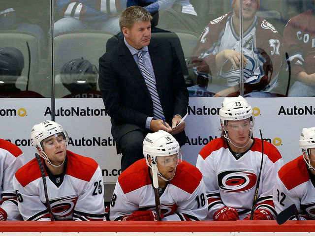 DENVER, CO - OCTOBER 21: Head coach Bill Peters of the Carolina Hurricanes leads his team against the Colorado Avalanche at Pepsi Center on October 21, 2015 in Denver, Colorado. The Hurricanes defeated the Avalanche 1-0 in overtime.