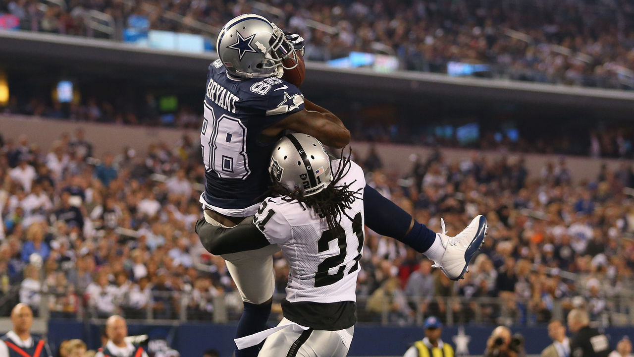 ARLINGTON, TX - NOVEMBER 28: Dez Bryant #88 of the Dallas Cowboys makes a touchdown pass reception against Mike Jenkins #21 of the Oakland Raiders at AT&T Stadium on November 28, 2013 in Arlington, Texas.