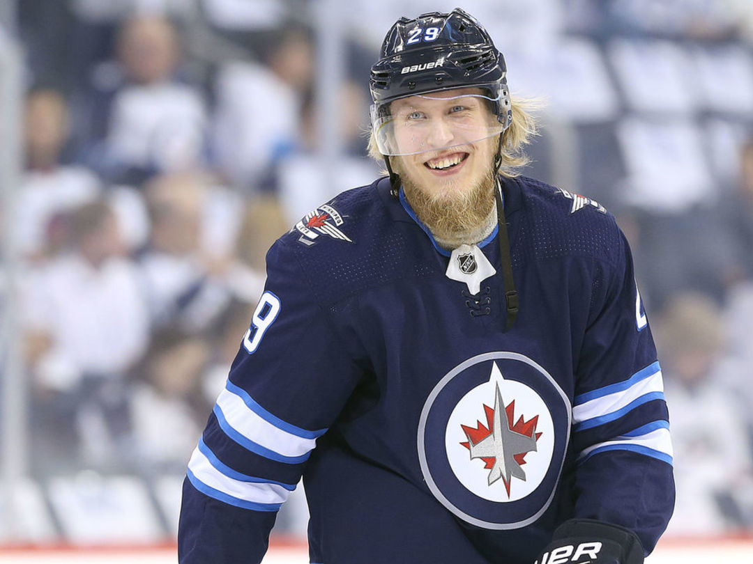 Watch: Did Laine pretend to play a sad violin as he skated by the Wild's bench?