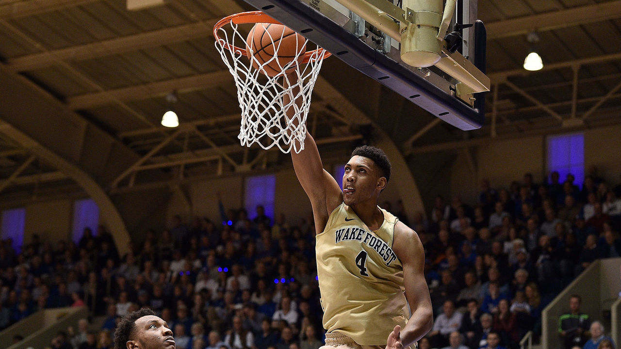DURHAM, NC - JANUARY 13: Doral Moore #4 of the Wake Forest Demon Deacons dunks against Wendell Carter Jr #34 of the Duke Blue Devils during their game at Cameron Indoor Stadium on January 13, 2018 in Durham, North Carolina. Duke won 89-71.