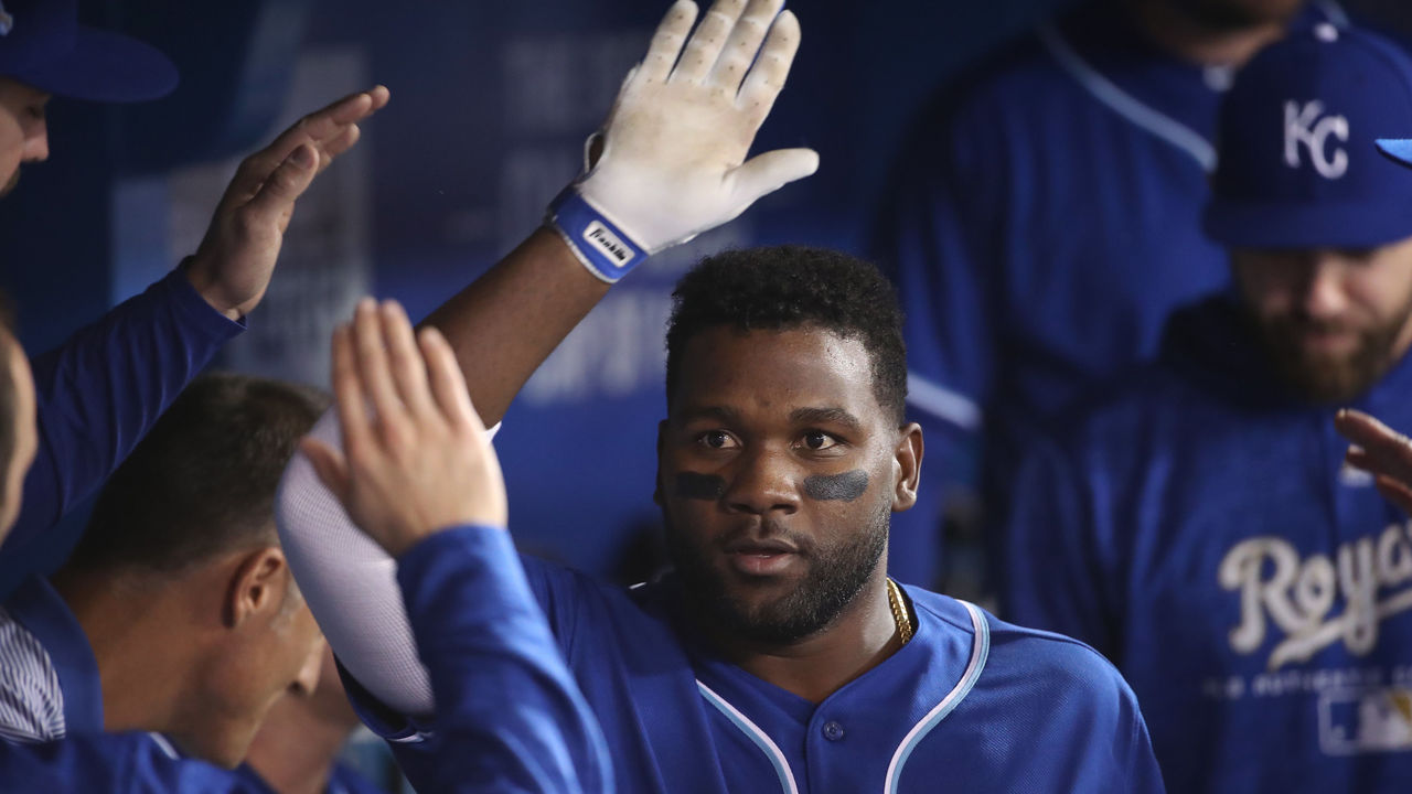 TORONTO, ON - APRIL 17: Abraham Almonte #45 of the Kansas City Royals is congratulated by teammates in the dugout after hitting a solo home run in the sixth inning during MLB game action against the Toronto Blue Jays at Rogers Centre on April 17, 2018 in Toronto, Canada.