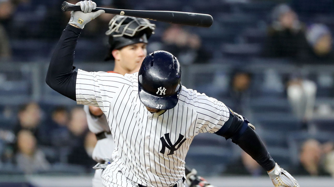 NEW YORK, NY - APRIL 17: Giancarlo Stanton #27 of the New York Yankees reacts after he hit a pop fly in the third inning as J.T. Realmuto #11 of the Miami Marlins defends at Yankee Stadium on April 17, 2018 in the Bronx borough of New York City.