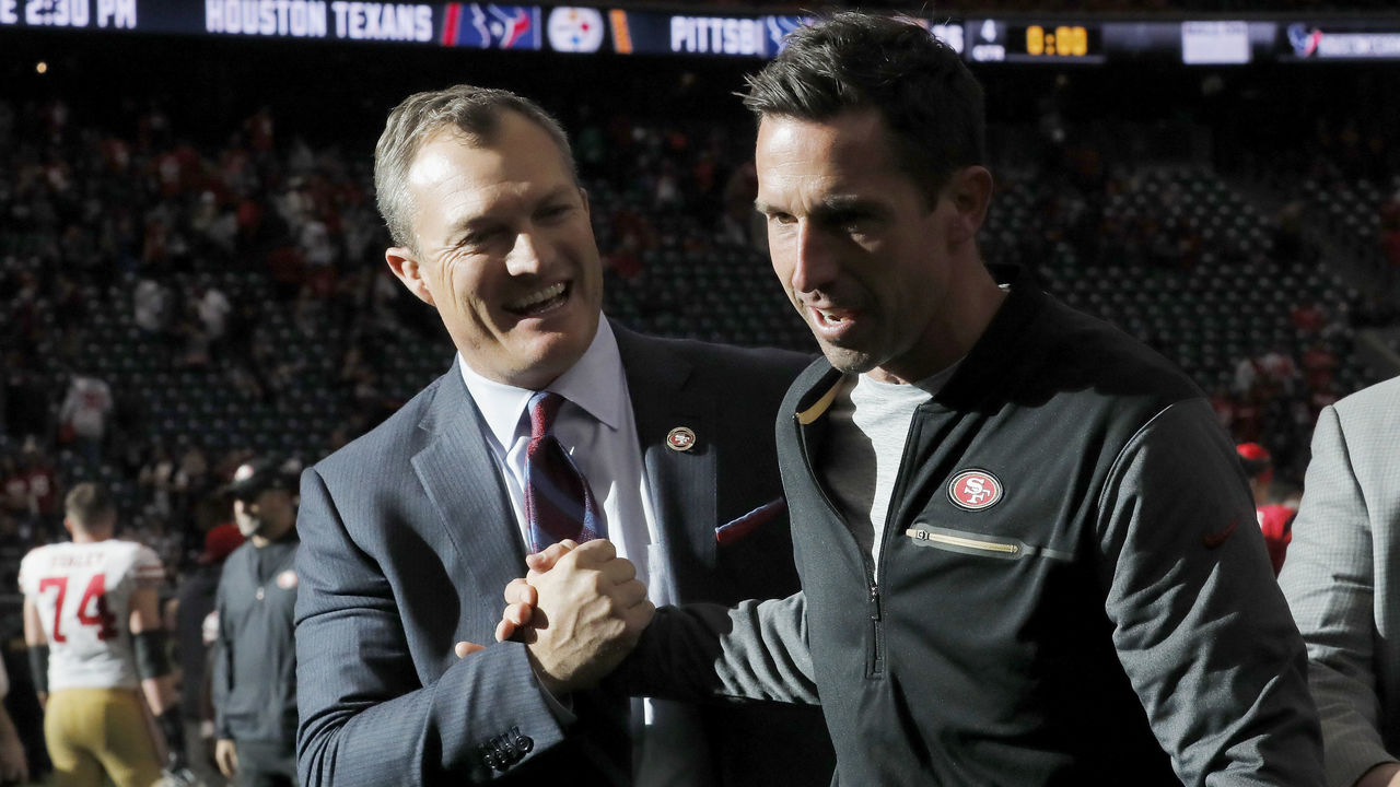 HOUSTON, TX - DECEMBER 10: Head coach Kyle Shanahan of the San Francisco 49ers celebrates with general manager John Lynch after the game against the Houston Texans at NRG Stadium on December 10, 2017 in Houston, Texas.