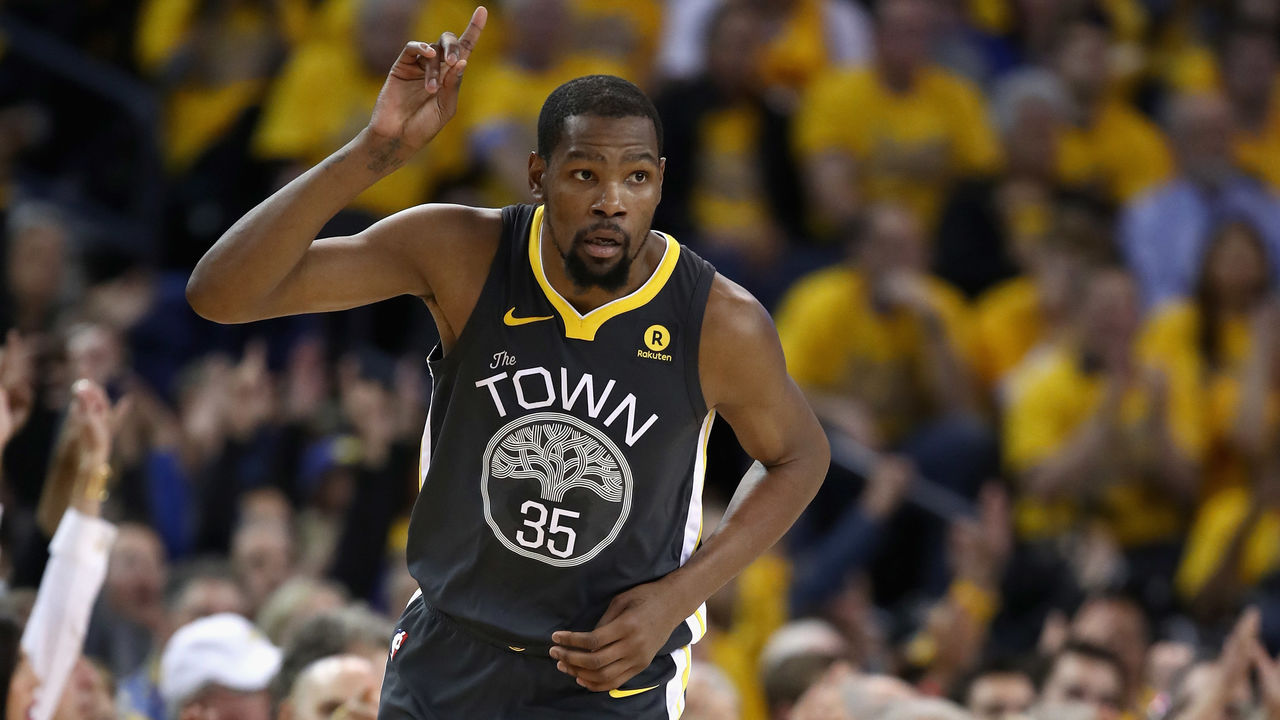 OAKLAND, CA - APRIL 16: Kevin Durant #35 of the Golden State Warriors reacts after he made a three-point basket against the San Antonio Spurs during Game 2 of Round 1 of the 2018 NBA Playoffs at ORACLE Arena on April 16, 2018 in Oakland, California.
