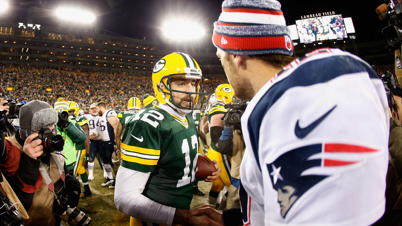 GREEN BAY, WI - NOVEMBER 30: Quarterbacks Aaron Rodgers #12 of the Green Bay Packers and Tom Brady #12 of the New England Patriots shake hands following the NFL game at Lambeau Field on November 30, 2014 in Green Bay, Wisconsin. The Packers defeated the Patriots 26-21.