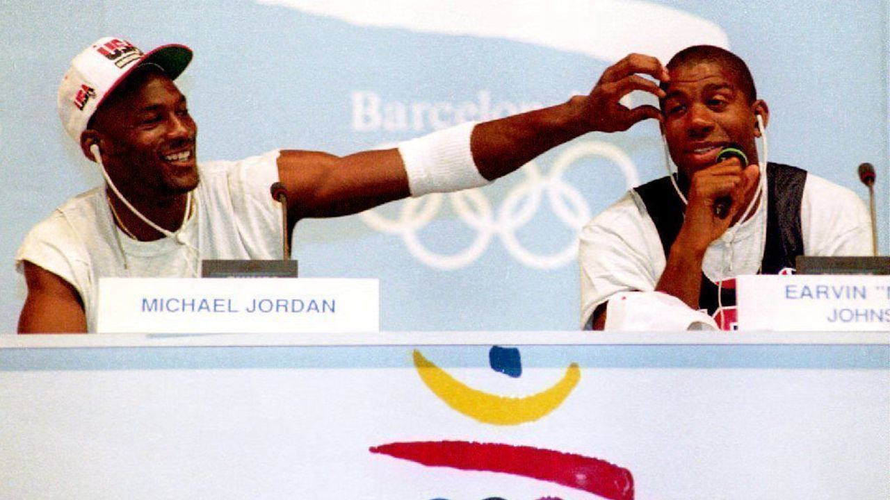 BARCELONA, SPAIN - JULY 25: Basketball stars Michael Jordan (L) and Earvin 'Magic' Johnson clown for the media 25 July during a press conference for the U.S. Olympic 'Dream Team.' The team is strongly favored to win the gold.