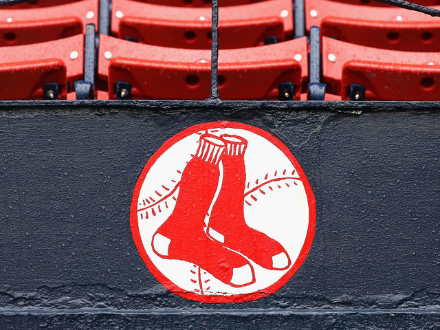 BOSTON MA - OCTOBER 09 Raindrops are seen on the Boston Red Sox logo after game three of the American League Divison Series between the Boston Red Sox and the Cleveland Indians was postponed due to weather at Fenway Park on October 9 2016 in Boston Massachusetts