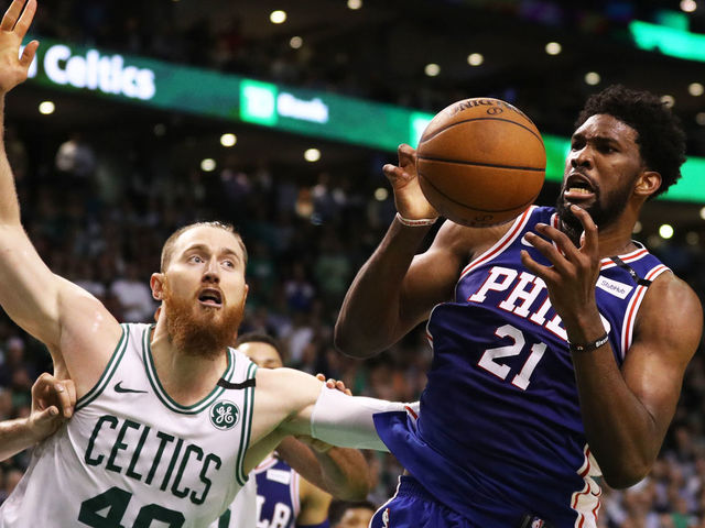 BOSTON MA - MAY 9 Aron Baynes 46 of the Boston Celtics and Joel Embiid 21 of the Philadelphia 76ers battle for a rebound during Game Five of the Eastern Conference Second Round of the 2018 NBA Playoffs at TD Garden on May 9 2018 in Boston Massachusetts The Celtics defeat the 76ers 114-112 to advance to the Eastern Conference Finals