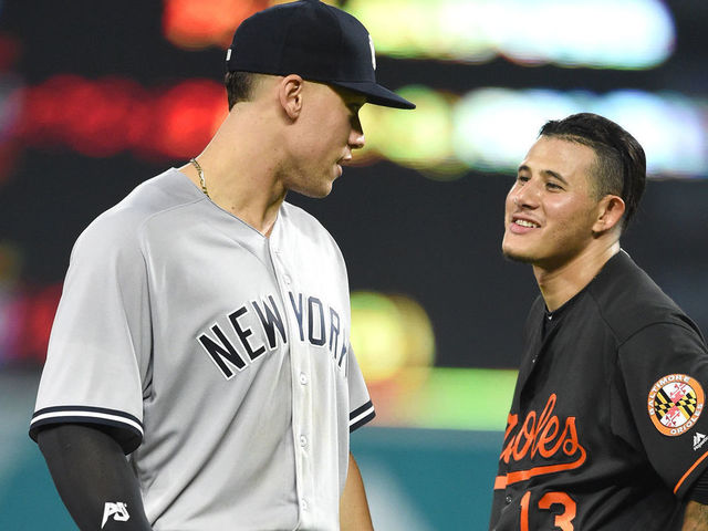 BALTIMORE MD - JUNE 01 Aaron Judge 99 of the New York Yankees and Manny Machado 13 of the Baltimore Orioles talk between inning pitches during a baseball game at Oriole Park at Camden Yards on June 1 2018 in Baltimore Maryland