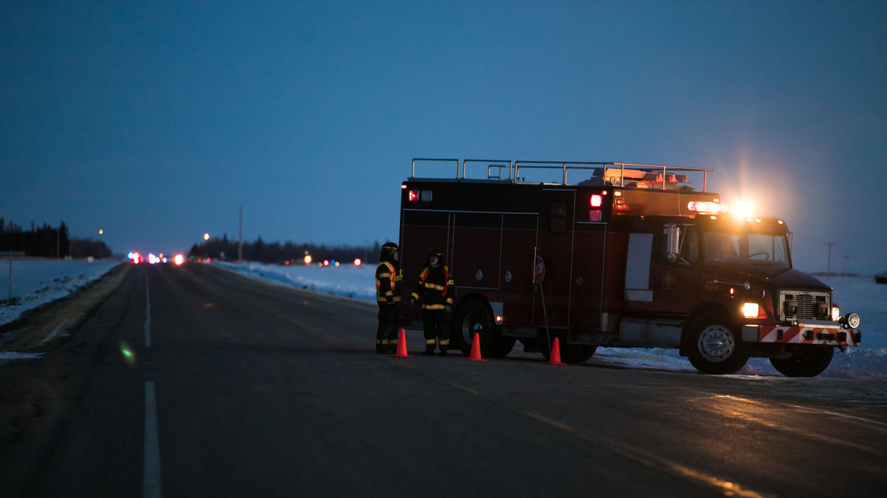 An emergency vehicle is seen near the crash site on April 6, 2018 after a bus carrying a junior ice hockey team collided with a semi-trailer truck between Tisdale and Nipawin, Saskatchewan province, killing 14 people. - Hockey-mad Canada was in mourning on Saturday after a bus carrying a junior ice hockey team collided with a semi-trailer truck in Saskatchewan province, killing 14 people.In a country where love of the sport is almost a religion, the crash sparked an outpouring of grief among players and fans on social media, while national political leaders expressed their sympathies.'We can now confirm 14 people have died as a result of this collision,' the Royal Canadian Mounted Police said in a statement, which did not say how many of the victims were players or coaches of the Humboldt Broncos team.