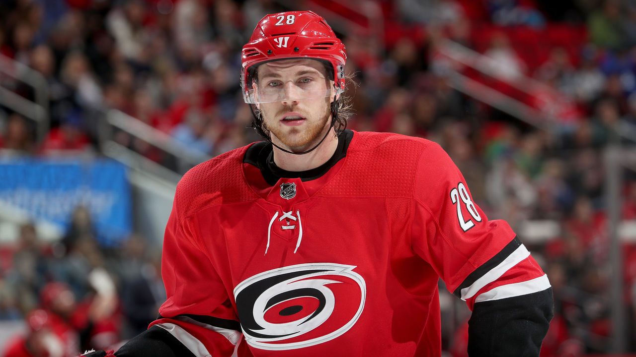 RALEIGH, NC - APRIL 7: Elias Lindholm #28 of the Carolina Hurricanes prepares for a faceoff during an NHL game against the Tampa Bay Lightning on April 7, 2018 at PNC Arena in Raleigh, North Carolina.