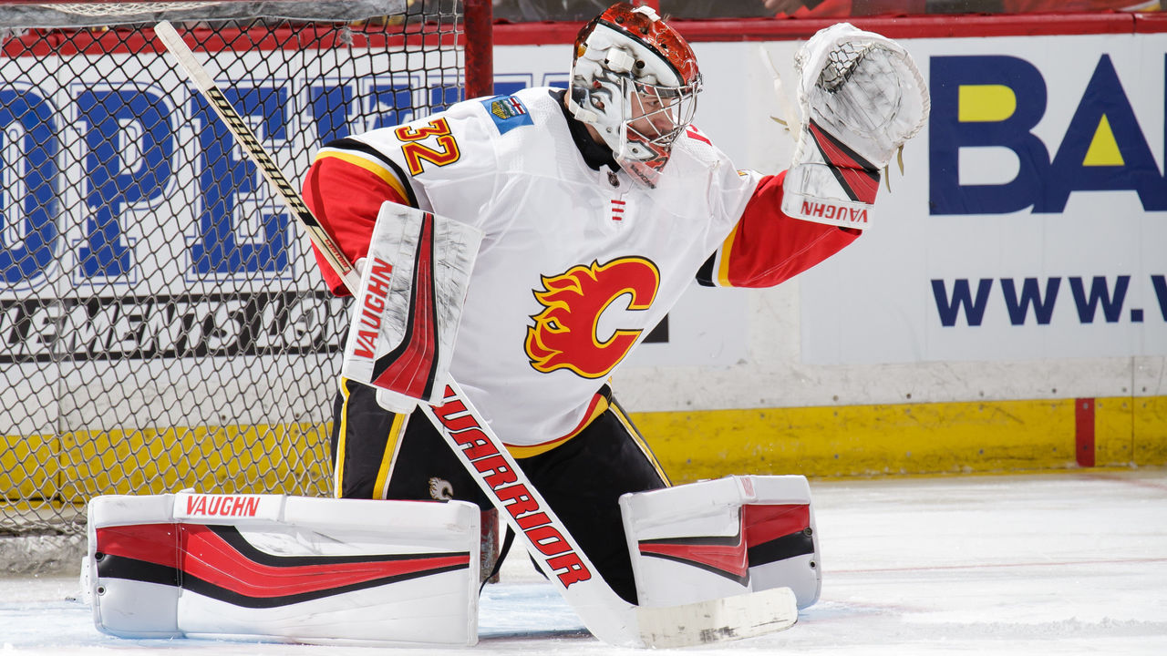 OTTAWA, ON - MARCH 9: Jon Gillies #32 of the Calgary Flames makes a save during warmups prior to a game against the Ottawa Senators at Canadian Tire Centre on March 9, 2018 in Ottawa, Ontario, Canada. *** Local Caption ***
