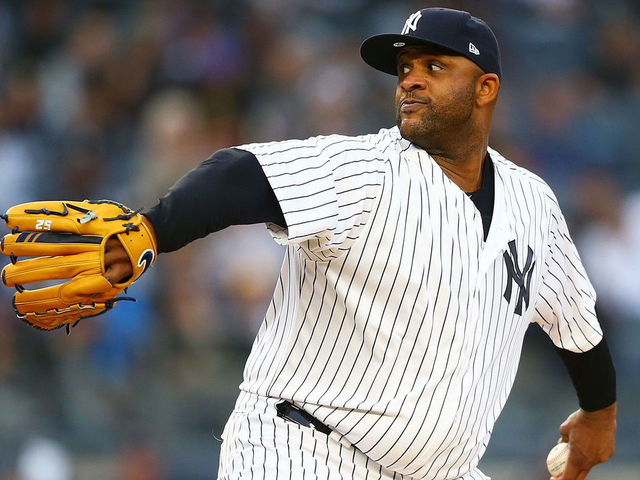 NEW YORK NY - MAY 10 CC Sabathia 52 of the New York Yankees pitches in the first inning against the Boston Red Sox at Yankee Stadium on May 10 2018 in the Bronx borough of New York City