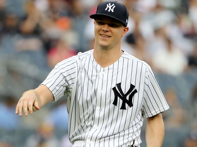 NEW YORK NY - AUGUST 01 Sonny Gray 55 of the New York Yankees reacts to the booing fans as he is pulled from the game in the third inning against the Baltimore Orioles at Yankee Stadium on August 1 2018 in the Bronx borough of New York City