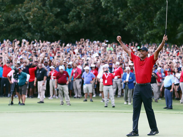 ATLANTA, GA - SEPTEMBER 23: Tiger Woods of the United States celebrates making a par on the 18th green to win the TOUR Championship at East Lake Golf Club on September 23, 2018 in Atlanta, Georgia.