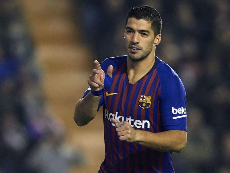 Barcelona crush Rayo's hopes with last-minute fightback