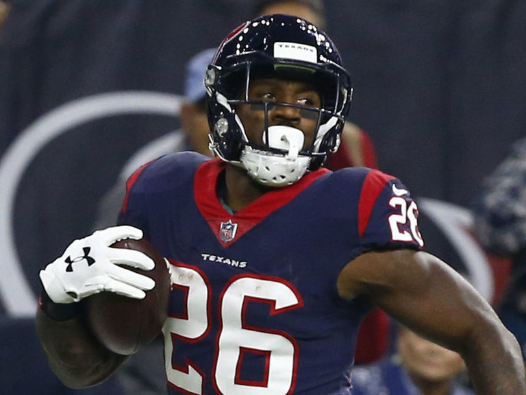 Texans' Miller carted off after taking hit to leg
