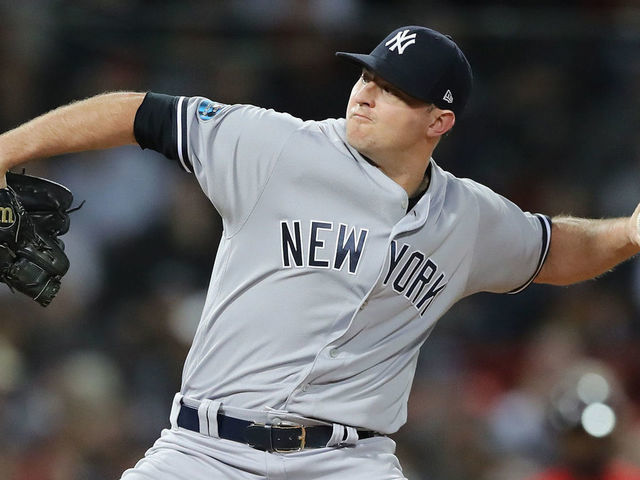 BOSTON, MA - OCTOBER 06: Pitcher Zach Britton #53 of the New York Yankees pitches during the eighth inning of Game Two of the American League Division Series against the Boston Red Sox at Fenway Park on October 6, 2018 in Boston, Massachusetts.