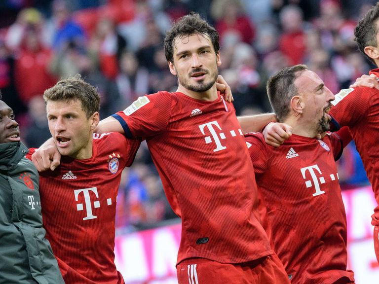 Bayern batter Wolfsburg to vault Dortmund for top spot