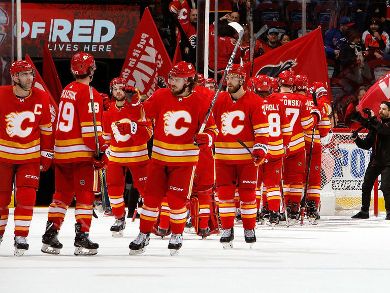 Flames clinch playoff berth after Islanders beat Wild
