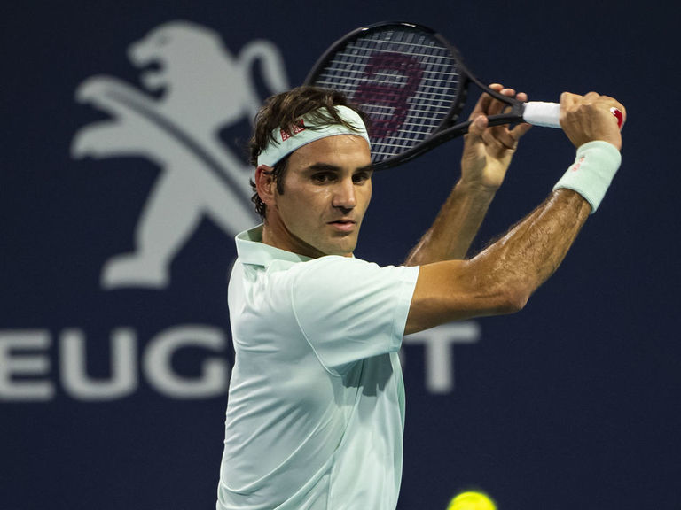 Federer tops Isner in straight sets to win Miami Open title