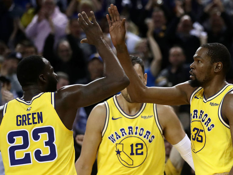 Warriors increase lead atop West by blowing out Nuggets