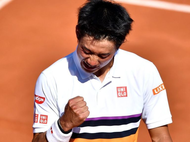 Nishikori survives marathon to defeat Djere