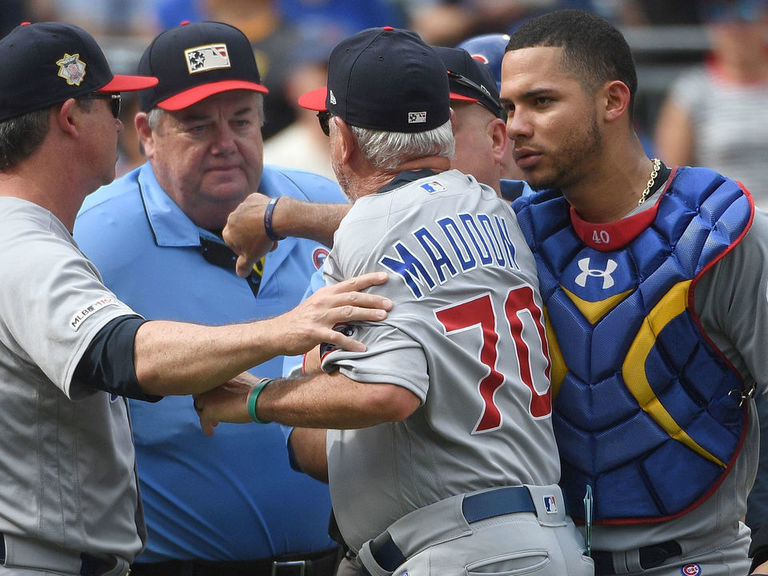 Maddon restrained by umpire, players during heated exchange with Pirat