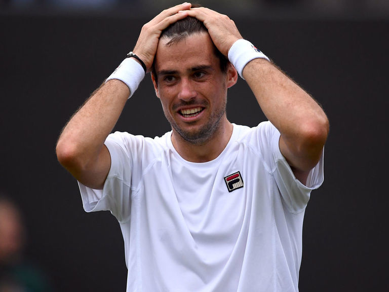 Pella storms back to beat Raonic, reach 1st Grand Slam quarterfinal