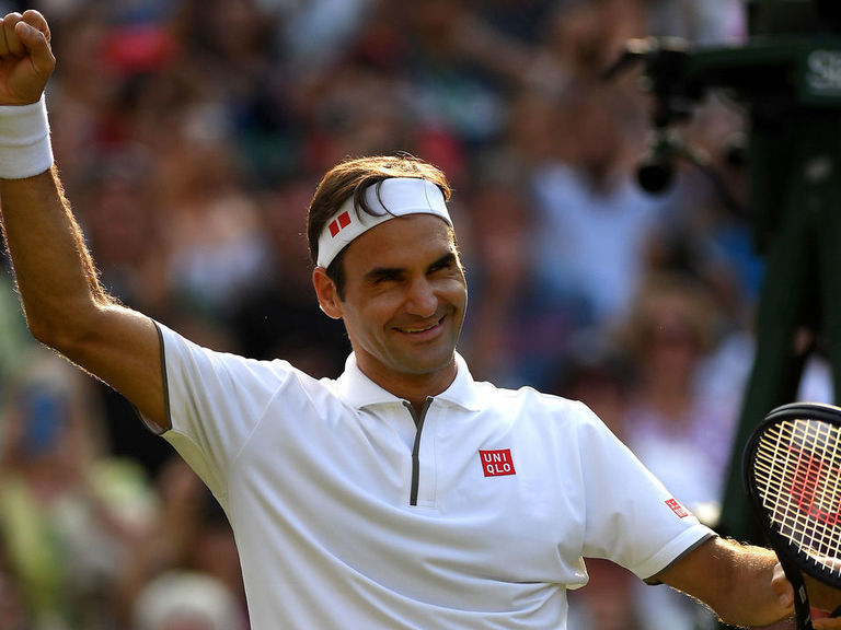 Federer into Wimbledon semifinals with 100th win at tournament