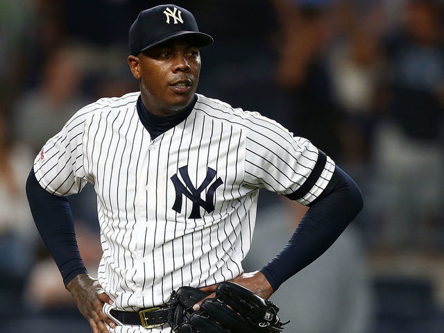 NEW YORK NEW YORK - JULY 15 Aroldis Chapman 54 of the New York Yankees reacts after giving up a three-run home run to Travis dArnaud 37 of the Tampa Bay Rays in the ninth inning at Yankee Stadium on July 15 2019 in New York City