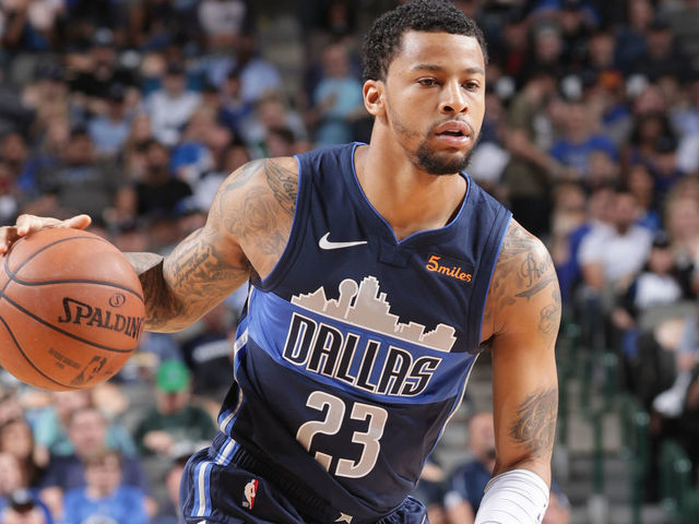 DALLAS TX - APRIL 5  Trey Burke 23 of the Dallas Mavericks handles the ball during the game against the Memphis Grizzlies on April 5 2019 at the American Airlines Center in Dallas Texas Mandatory Copyright Notice Copyright 2019 NBAE