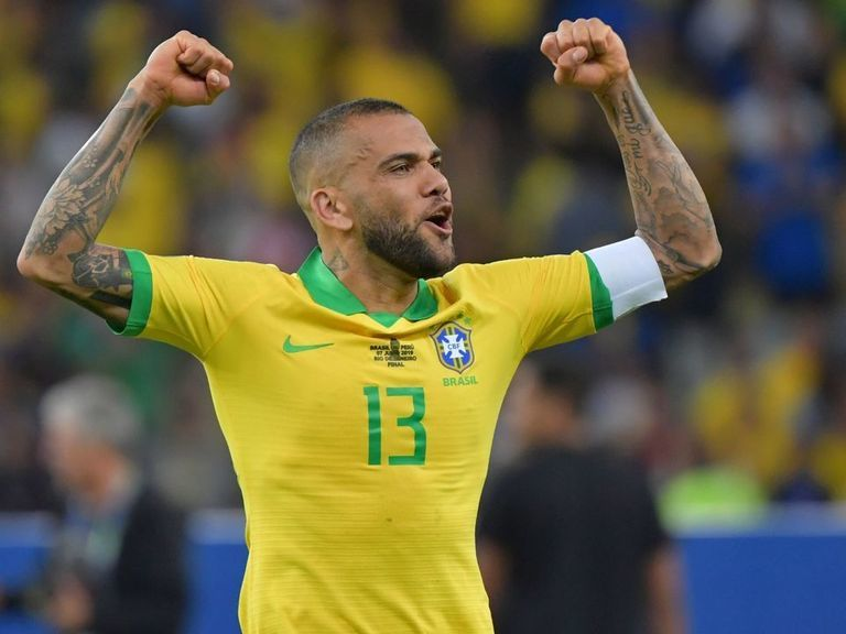 Dani Alves signs with Sao Paulo in return to Brazil