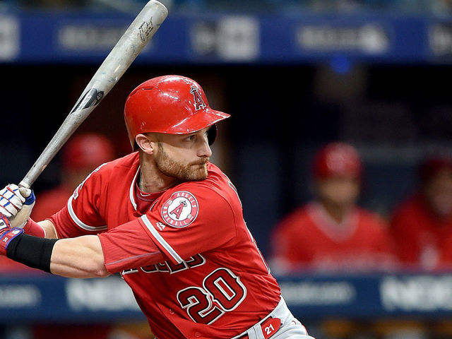 ST PETERSBURG FL - JUNE 14 Jonathan Lucroy 20 of the Los Angeles Angels bats against the Tampa Bay Rays at Tropicana Field on June 14 2019 in St Petersburg Florida