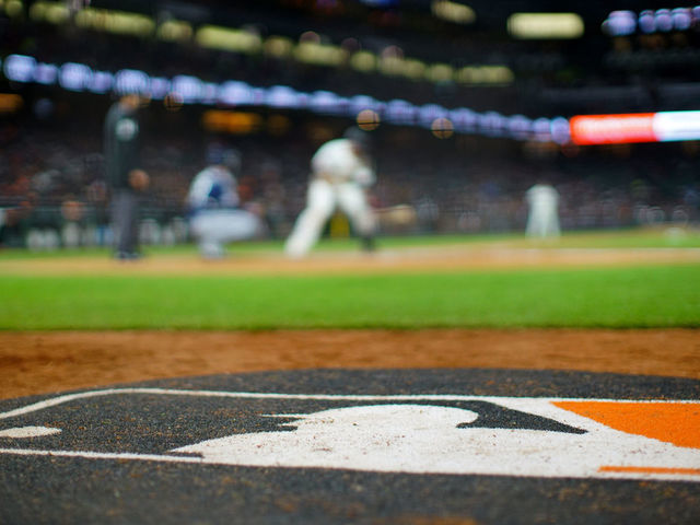SAN FRANCISCO CALIFORNIA - APRIL 09 A detailed view of the MLB logo on the on deck circle during the game between the San Francisco Giants and the San Diego Padres at Oracle Park on April 09 2019 in San Francisco California